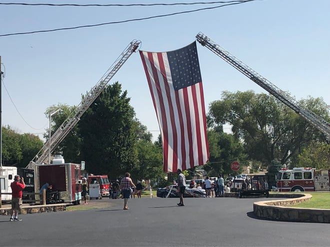 A 30-by-28-foot American flag was held up by Rocky Ford and La Junta Fire Department trucks throughout the ceremony honoring 9/11 victims in La Junta City Park.