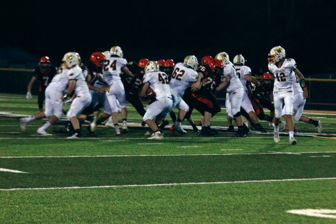 The Macomb defense makes a stop during Friday night's game against ROWVA/Williamsfield.