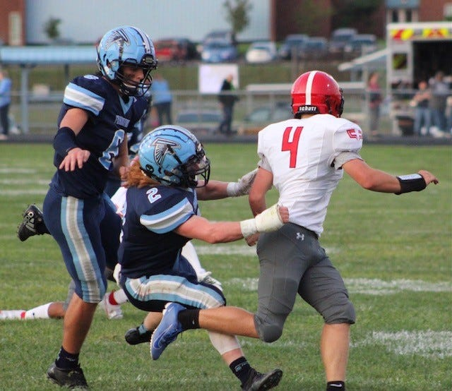 Frankfort's Peyton Clark and Luke Robinette chase a Washington defender Friday as the Falcons fought to avenge their heartbreakingly close 2020 loss to the Patriots. The Frankfort defense was successful in their mission, shutting out the Patriots 21-0. The Falcons are now 3-0 for the season.