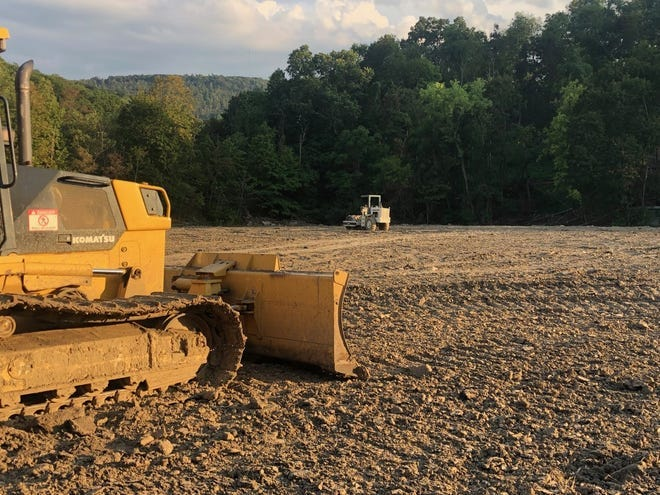 It cost the City of Keyser $17,600 to have contractor J.R. Lucas level out the dirt pile which Mineral County's commissioners had allowed the city to dump on the former tennis courts back in 2013. Some city residents have since questioned whether the city legally handled the bid process.