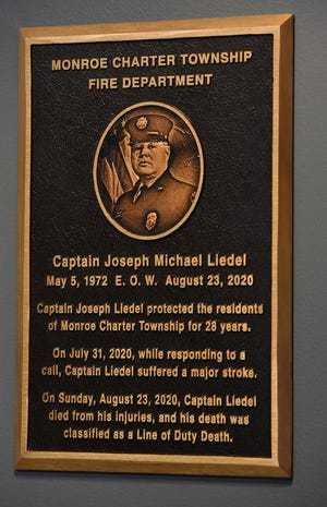 The memorial plaque for Captain Joseph Liedel at the Monroe Township Fire Department.
