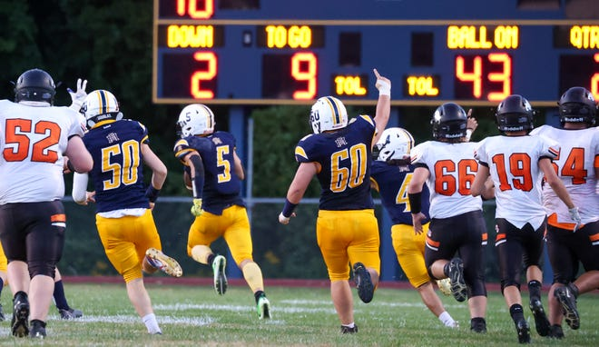 Erie Mason's Bryce Gardiner (60) cheers as Bryce Diehl scores a touchdown against Summerfield Friday night. Mason was scheduled to play Adrian Madison Friday, but the game has been cancelled due to COVID-19 tracing within the Madison football team.
