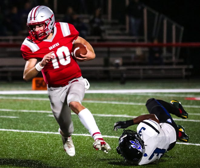 Canandaigua quarterback Bryan Boldrin escapes a Brockport tackle during Friday's game.