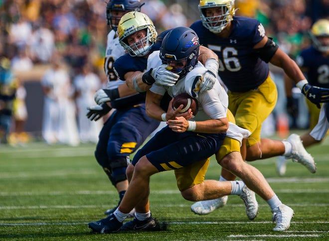 Notre Dame's JD Bertrand (27) sacks Toledo's Carter Bradley (2) during the Notre Dame vs. Toledo NCAA football game Saturday, Sept. 11, 2021 at Notre Dame Stadium in South Bend.