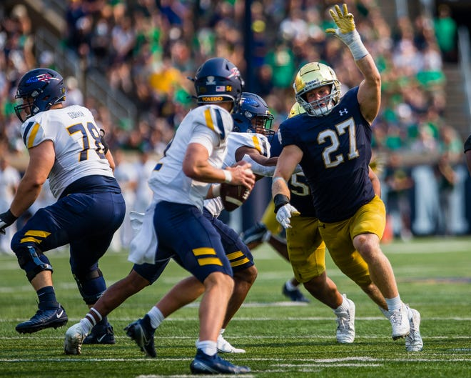 Notre Dame's JD Bertrand (27) chases down Toledo's Carter Bradley (2) during the Notre Dame vs. Toledo NCAA football game Saturday, Sept. 11, 2021 at Notre Dame Stadium in South Bend.