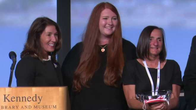 Annette Szivos, of Gardner, right, was presented with the Madeline Amy Sweeney Award for Civilian Bravery at the John F. Kennedy Presidential Library and Museum in Boston on Saturday, Sept. 11, 2021, by Lt. Gov. Karyn Polito, left. Sweeney's daughter, Anna Sweeney, center, was on hand for the presentation.