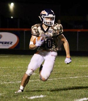 Pontiac's Kodi Davis looks for running room during the Indians' 20-14 win at home over Rantoul Friday.