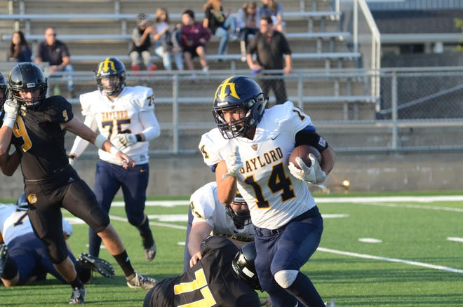 Gaylord halfback, Austin Vanderveer, runs the ball against Traverse City Central High School. Vanderveer leads the team with 64 rushing yards in the game.