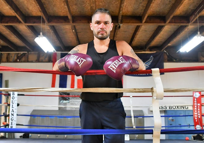 """Ryan Clark played football and baseball at Dover High School, but says boxing  is """"the most physically exhausting sport I've ever been a part of."""""""
