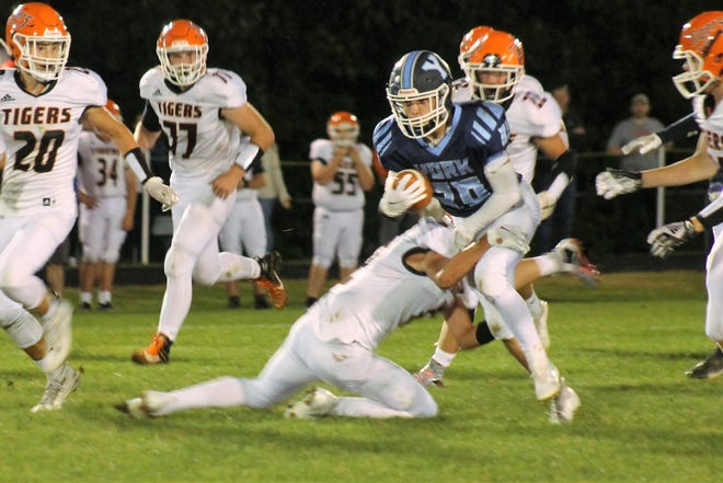 York's Caleb Pappagallo (30) tries to break a tackle during the Wildcats' Class C South game Friday against Gardiner in York, Maine.