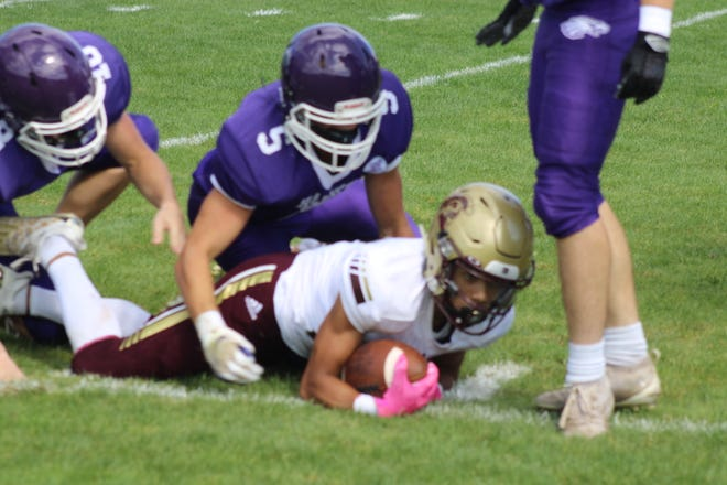Marshwood's Kevin Couglar (5) making a tackle on Thornton Academy running back during Satudray's 33-17 loss.