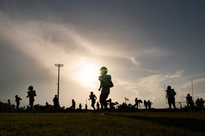 Benjamin players warm up for their game against Cardinal Newman Benjamin in West Palm Beach, Florida on September 10, 2021.