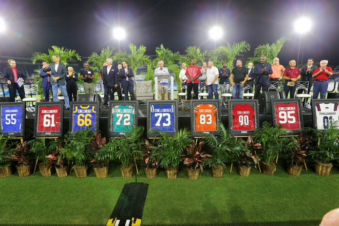 Part of Friday night's event was the display of nine jerseys, each of a team that Howard Schnellenberger had been a part of, on the stage with his name on the back of each and the number representing a year of his significance with that team.