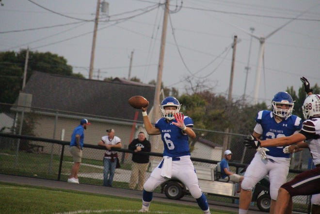 Perry's Caden Heck looks to make a pass on Friday, Sept. 10, 2021, at Dewey Field in Perry.
