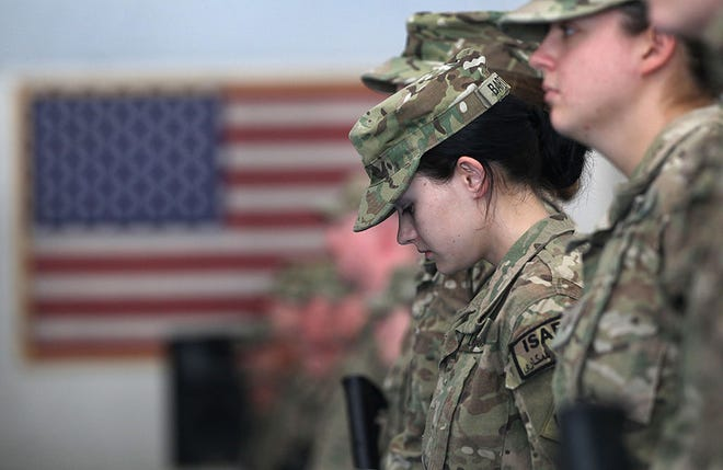 Oklahoma National Guard soldier PFC. Sarah Bartodei, 19, and fellow soldiers gather to receive their combat action patches on September 11, 2011 at Bagram Air Field, Afghanistan.