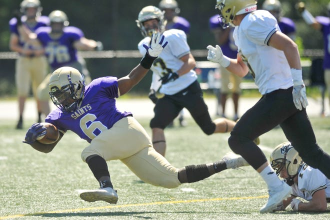 Henrique Ross got tripped up on this run, but the St. Raphael football team certainly didn't in Eric Rueb's latest high school football Top 20 Power Poll.