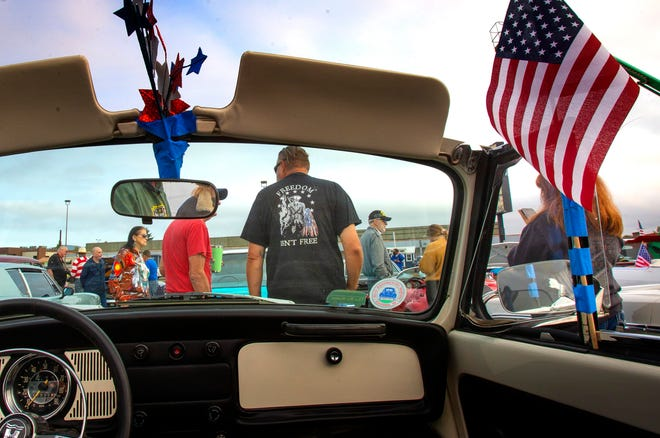 Car owners and supporters gather in the parking lot of the Springfield Elks Club before participating in a car parade through Springfield and Eugene to pay tribute to first responders on the 20th anniversary of the attacks of September 11, 2001.