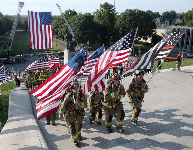 Firefighters participate in the Memorial Climb on the steps of the McKinley Presidential Library & Museum in Canton on Saturday. The event marked the 20th anniversary of the 9/11 attacks and recalled the memory of the 343 firefighters who lost their lives that day.