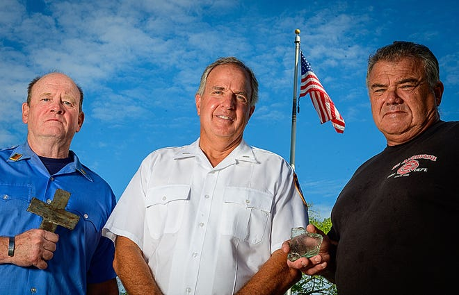 Retired New York City firefighters Gerard Durkin, Robert Aponte and John Westfield stand together in front of the City of St. Augustine's main fire station on Wednesday, Sept. 8, 2021. The three men worked for the FDNY on Sept. 11, 2001, during the terrorist attacks on the World Trade Center.