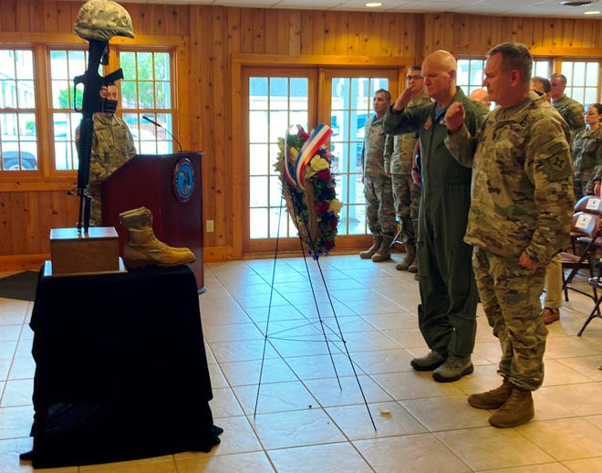 Maj. Gen. James Eifert, left, the adjutant general of Florida, and Command Sgt. Maj. David Lanham, the senior enlisted leader for the Florida National Guard, finish a salute in front of a wreath placed during a ceremony remembering the 20th anniversary of 9/11, people who died in the attacks and military members who died in the war on terrorism. The ceremony took place Friday afternoon in the St. Francis Barracks at the Florida National Guard headquarters in St. Augustine.