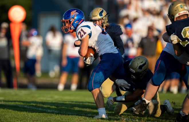 Edwardsburg's Connor Ostrander runs with the ball during the Edwardsburg-Niles high school football game on Friday, September 10, 2021, at Viking Stadium in Niles, Michigan.