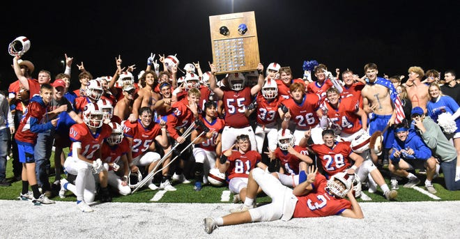 Patriot football players and fans celebrate after capturing the Black & Blue trophy on the 50th anniversary of the rivalry game with Edgewood Friday night. More photos from the game are featured in today's Spencer Evening World.