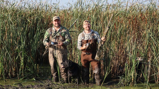 Brandon Butler (left), Willie and Shawn Jenkins with a pair of opening day Blue-winged Teal.