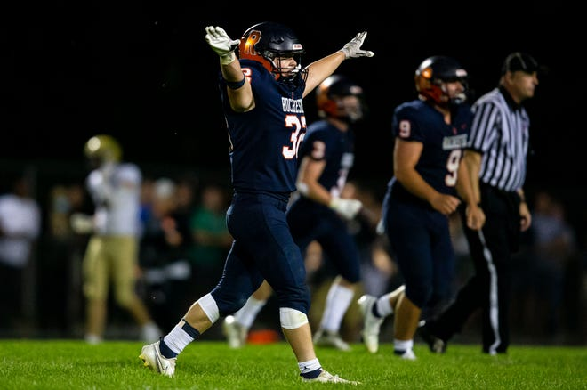 Rochester's Daniel Chapin (32) celebrates as defensive stop by the Rockets against Sacred Heart-Griffin in the second half at Rocket Booster Stadium in Rochester, Ill., Friday, September 10, 2021. [Justin L. Fowler/The State Journal-Register]