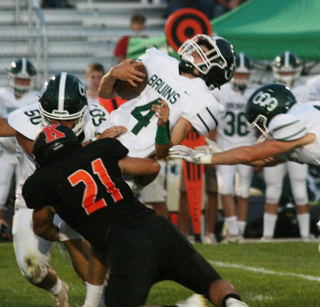 KHS linebacker Josh Nimrick crushes St. Bede's quarterback in the first half.