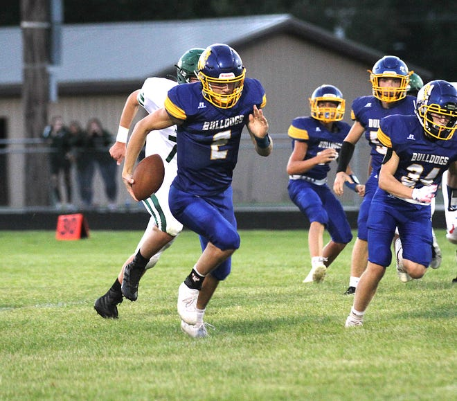 Centreville quarterback Tyler Swanwick breaks free for a touchdown run against Hartford in the second quarter on Friday night.