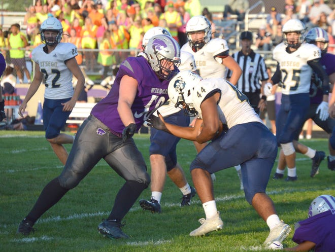 Three Rivers' Dillon Harper makes a tackle of Otsego's Noah Chambers in prep football action on Friday.