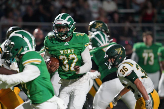 Kevon Daniels scored three touchdowns Friday night in a road win over Ashley. Ken Oots/StarNews
