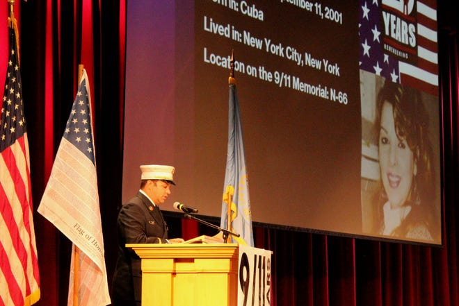 Aberdeen Fire & Rescue Lt. Lance Hammrich was one of several people who identified and gave brief biographies of 50 of the nearly 3,000 people who died in the Sept. 11, 2001, terrorist attacks. The 9/11 ceremony was on the campus of Northern State University.