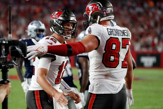Tampa Bay Buccaneers quarterback Tom Brady celebrates with tight end Rob Gronkowski after Gronkowski caught a 2-yard touchdown pass Thursday, in Tampa, Fla.