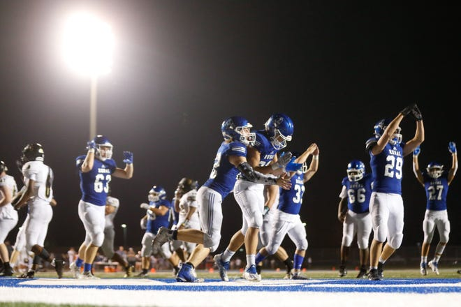 Washburn Rural players celebrate after getting a safety from Topeka West in the second half of Friday's game. The Junior Blues won 42-13.