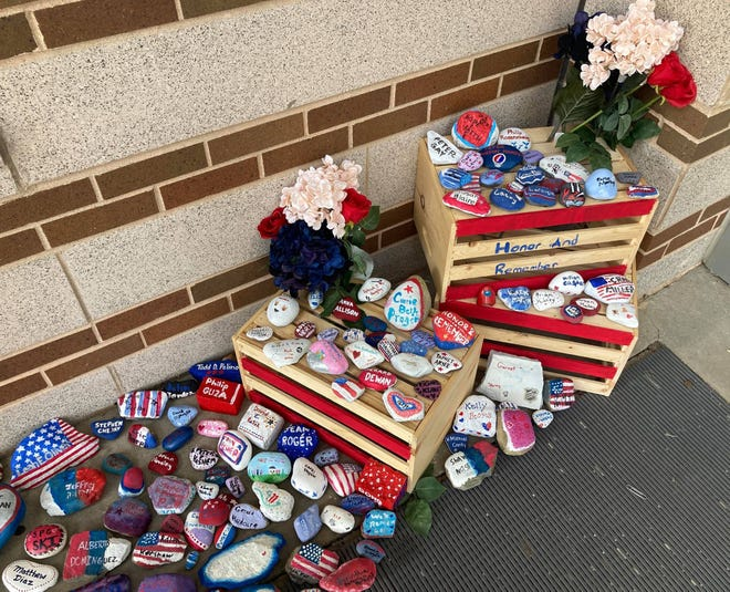 Rocks decorated by Nashoba students to remember those who died in the Sept. 11, 2001, terrorist attacks.