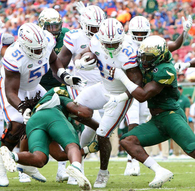 Florida running back Dameon Pierce pushes through USF defenders to score the Gators' first touchdown Saturday at Raymond James Stadium in Tampa.