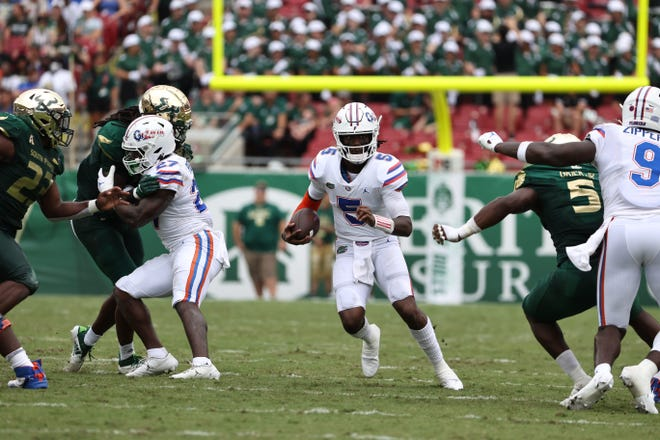 Florida quarterback Emory Jones threw a 35-yard TD pass to Xzavier Henderson and scored on a 33-yard run on the way to a 35-3 halftime lead Saturday against USF before a crowd of 66,646 at Raymond James Stadium in Tampa.