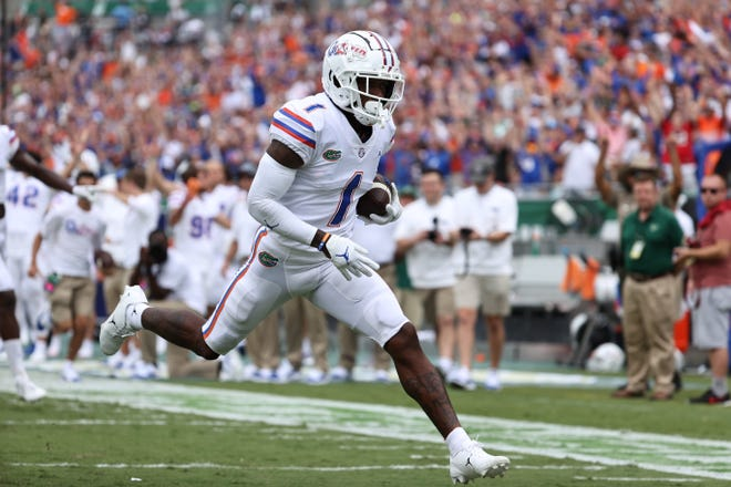 Florida wide receiver Jacob Copeland runs in for a touchdown during the second quarter Saturday against South Florida  at Raymond James Stadium in Tampa.