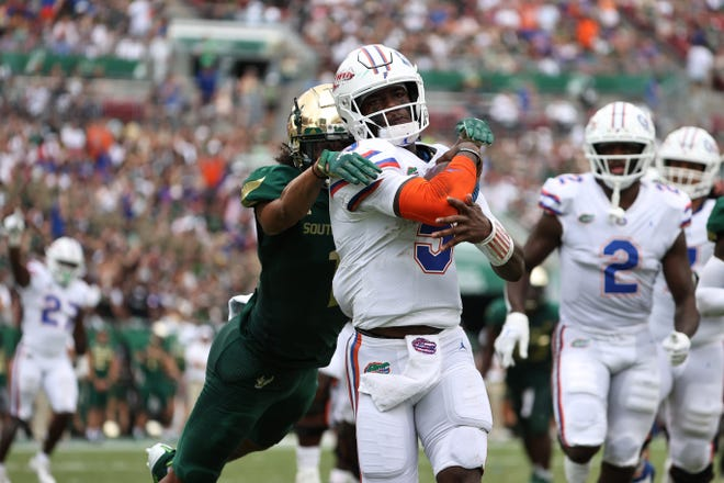 Florida quarterback Emory Jones rushes for a touchdown during the second quarter Saturday against the South Florida Bulls at Raymond James Stadium in Tampa.