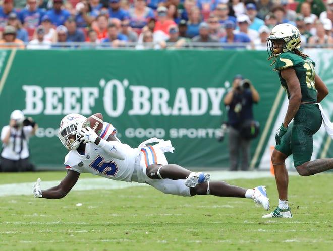 Florida Gators cornerback Kaiir Elam (5) grabs an interception during the second game of the season against the USF Bulls at Raymond James Stadium, in Tampa Fla. Sept. 11, 2021.