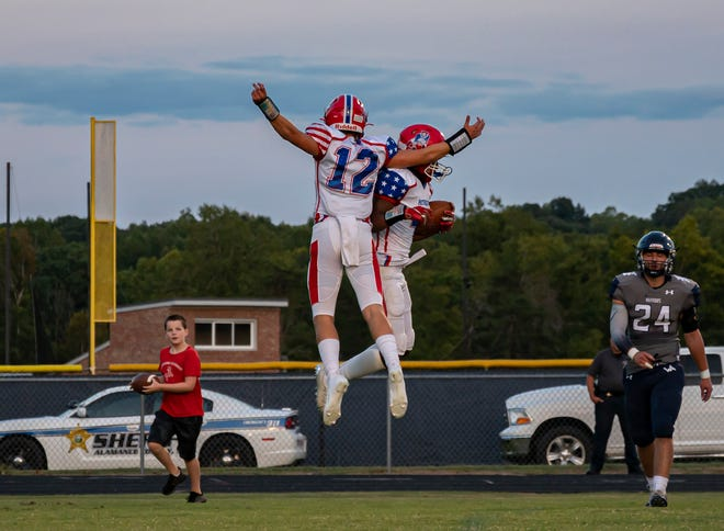 Southern Alamance High School seniors, Mitchell Mcclendon and Nevaeh Gattis celebrate a touchdown during their Friday night game against Western Alamance in Elon on September 10, 2021.
