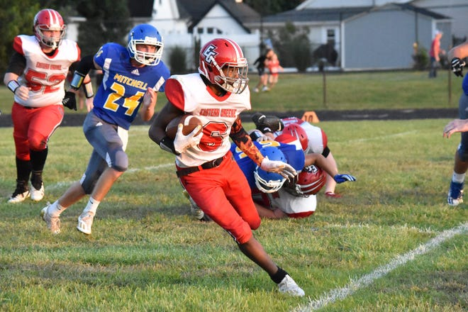 Eastern Greene running back James Lewis IV makes a cut against Mitchell.