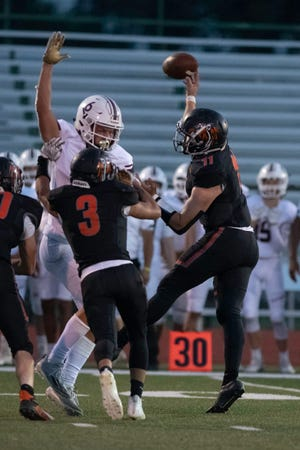 La Junta High School's Luke Garner throws a jump pass during a matchup with Alamosa on Friday September 10, 2021.