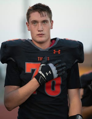 La Junta High School's TrentJohnston listens to the national anthem at Pueblo County Hornet Stadium ahead of a matchup with Alamosa on Friday September 10, 2021.