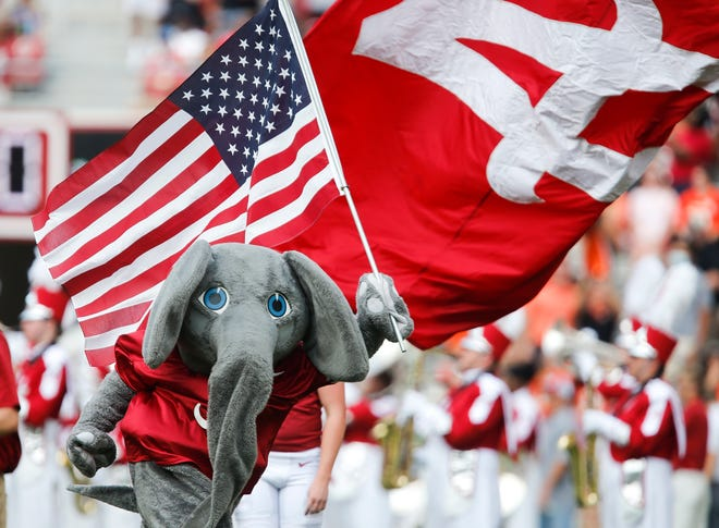 The Rising Tide Capital Campaign is designed to raise money for a variety of University of Alabama campus improvement, including upgrades at athletics facilities. UA mascot Big Al carries the American flag  as he runs onto the field Saturday, Sept. 11, 2021, in Bryant-Denny Stadium. [Staff Photo/Gary Cosby Jr.]