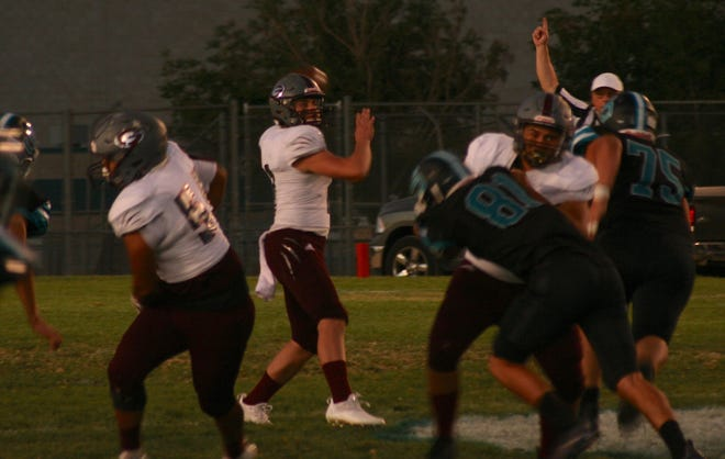 Granite Hills quarterback Byron Rivas, center, looks to pass the ball against Sultana at Jay Reed Field on Sept. 10, 2021.