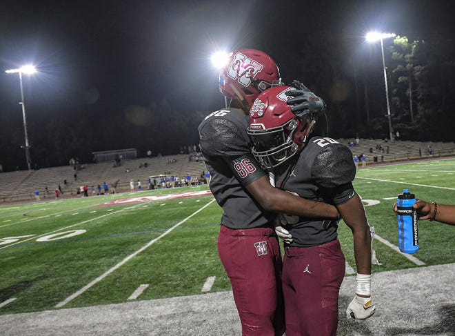 Westside High senior Kaziaes Hemphill (86) hugs senior Amir Dendy (20) after his long touchdown run against Byrnes helped seal a win during the fourth quarter in Anderson, S.C. Friday, September 10, 2021. Westside won 64-62.