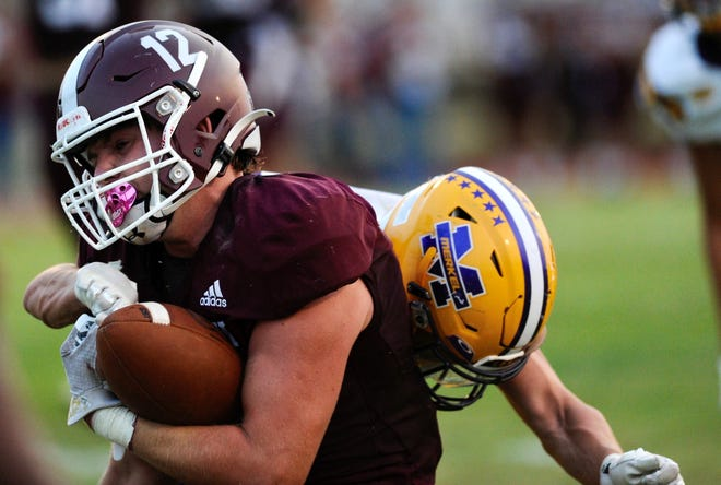 Hawley running back Austin Cumpton (12) plows for yards against Merkel on Friday night in Merkel. The Bearcats improved to 3-0 with a 41-7 win over the Badgers. Sept. 10 2021