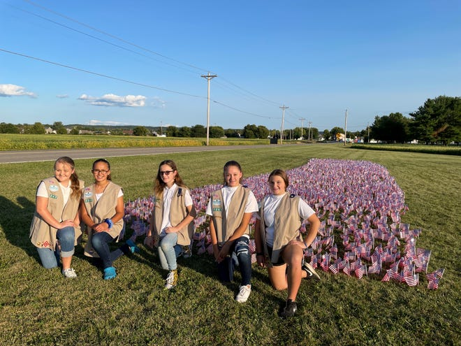 Lily Salyers, Gwen Pierce, Katt Ebright, Akira Robinson, Riley Puckett are members of the Frankfort Troop 1247 who placed flags at Greenlawn Cemetery.